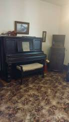 Music room and original flute (on top of piano)
